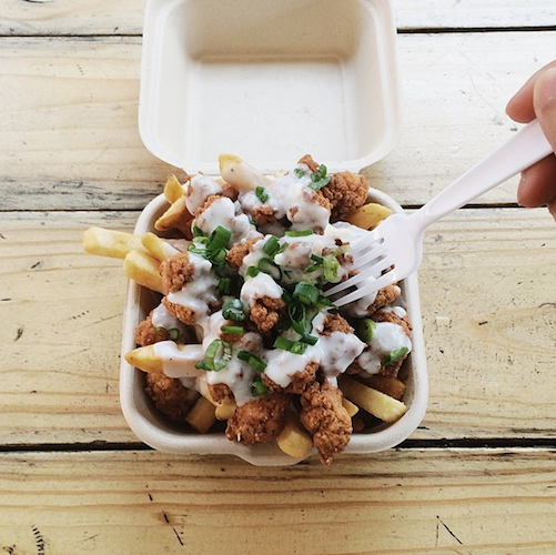 Disco fries have nothing on these bad boys. They're topped with fried chicken and country gravy. Photo: