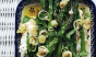 Bright spears of asparagus pop against a whicker background. Photo: