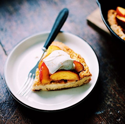 A slice of peach pie looks even more luscious with a dollop of whipped cream. Photo: