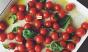 Cherry tomatoes, basil, enamel ware...looks like summer. Photo: