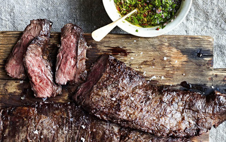 ARGENTINA: Skirt Steak with Chimichurri Sauce (Churrasco con Chimichurri). Tart, herbaceous, and absolutely addictive, Argentinean chimichurri sauce is the perfect match for the rich beefy flavor of skirt steak.