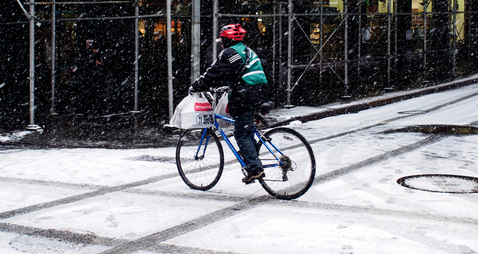 A delivery worker braves the New York winter. Photo: EJP Photo/ Flickr