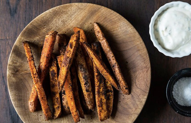 Southwestern Spiced Sweet Potato fries with Chili-Cilantro Sour Cream. The brilliance of the sweet potato fry is that with all the sugar in the potatoes, you can really lay on the seasonings.