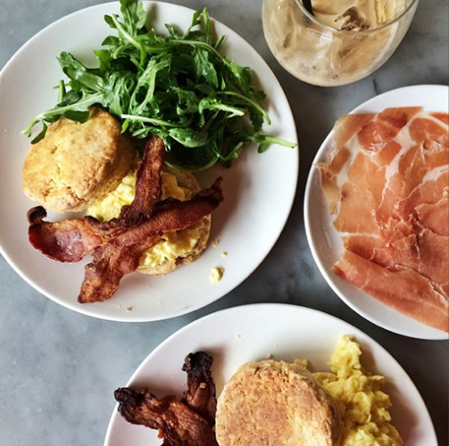 A very balanced breakfast of eggs, bacon, prosciutto, and biscuits. Photo: