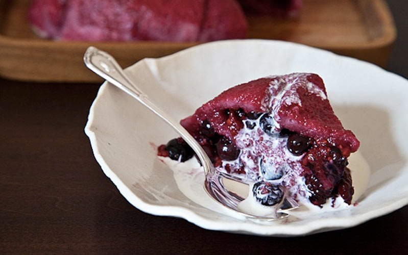 Berry Summer Pudding. The pudding is the essence of summer: the bread absorbs the juices and melts into a sweet, fragrant sponge, and when you cut into the pudding, the berries tumble out like so many rubies and sapphires.