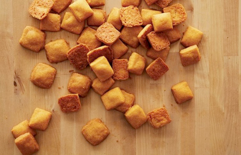 Cheez-Its. The paprika is responsible for the tang; the better the cheese you use, the sharper and more elegant the taste, yet they will still remain distinctly Cheez-It-esque.