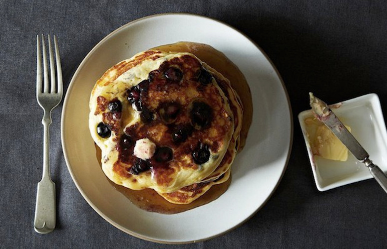 Lemony Cream Cheese Pancakes with Blueberries. The trio of lemon, cream cheese, and tangy sweet blueberries is subtle yet seductive—a combination that can only be improved upon with a generous slathering of excellent quality maple syrup.