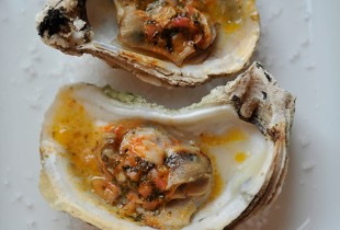 Grilled (or Broiled) Oysters with a Sriracha Lime Butter. Everybody loves an open flame. As it turns out, oysters do too. The quick blast