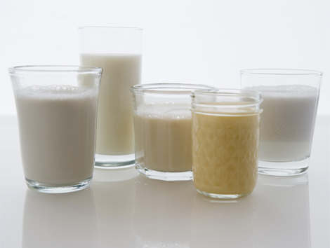 A selection of plant milks. Jamie Grill—Getty Images/Tetra images RF, via Time.