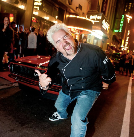 Guy Fieri outside his Times Square restaurant. (Photo: Facebook)